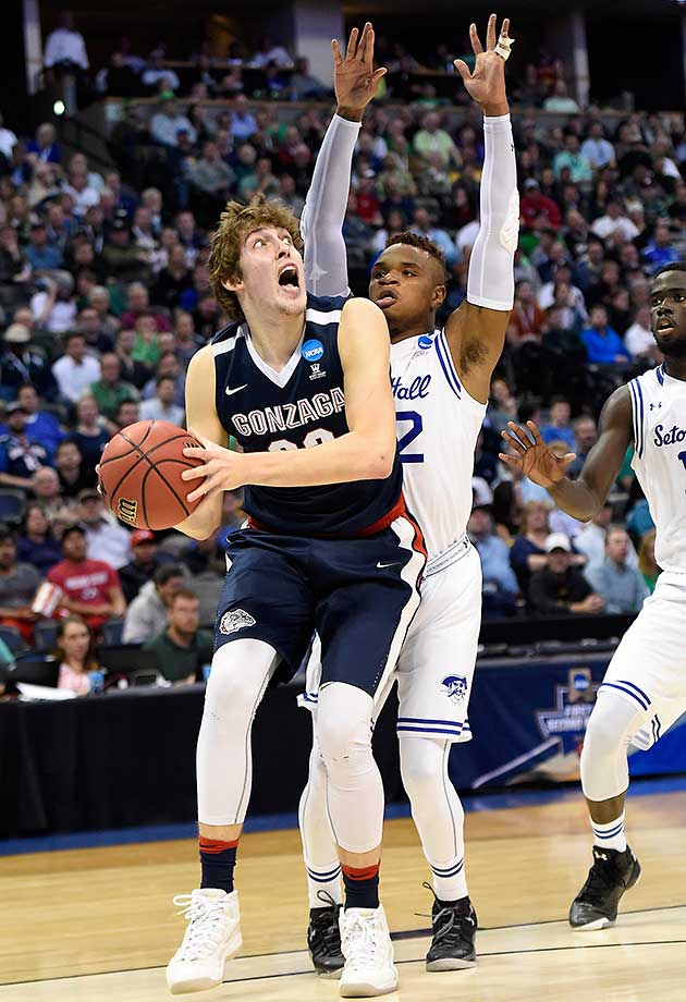 Gonzaga forward Kyle Wiltjer works under the basket as Seton Hall's Derrick Gordon (32) defends.