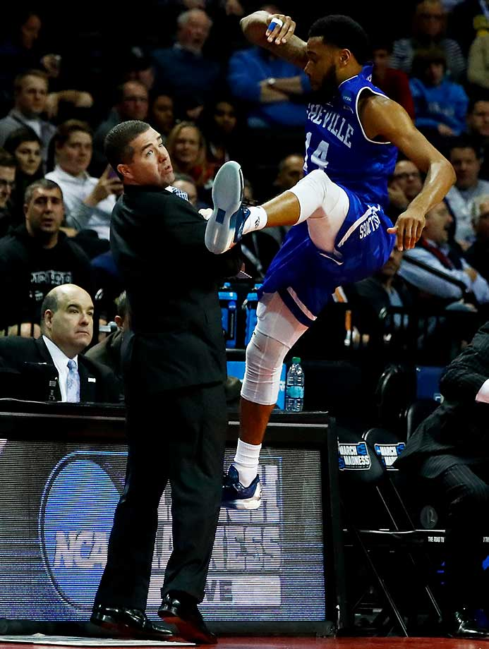 Ahmad Thomas falls into UNC Asheville coach Nick McDevitt during a loss to Villanova.