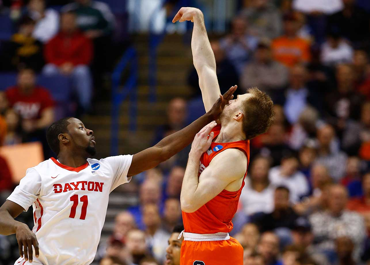 Trevor Cooney of Syracuse shoots and is fouled by Scoochie Smith in a win over the Dayton Flyers.