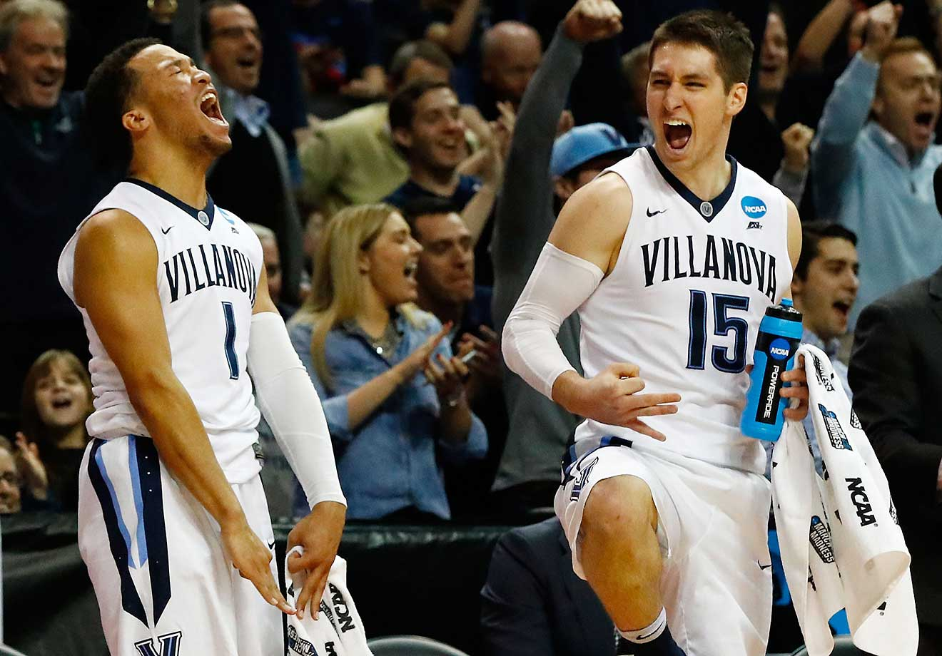 Jalen Brunson and Ryan Arcidiacono celebrate a 30-point victory over UNC Asheville Bulldogs.