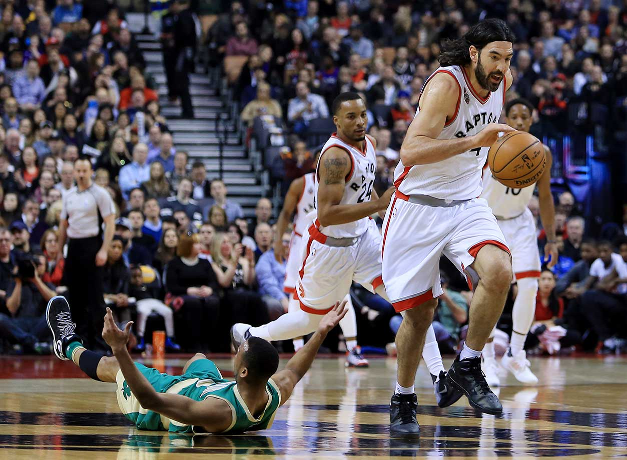 Luis Scola of Toronto Raptors steals the ball away from Avery Bradley of the Boston Celtics.
