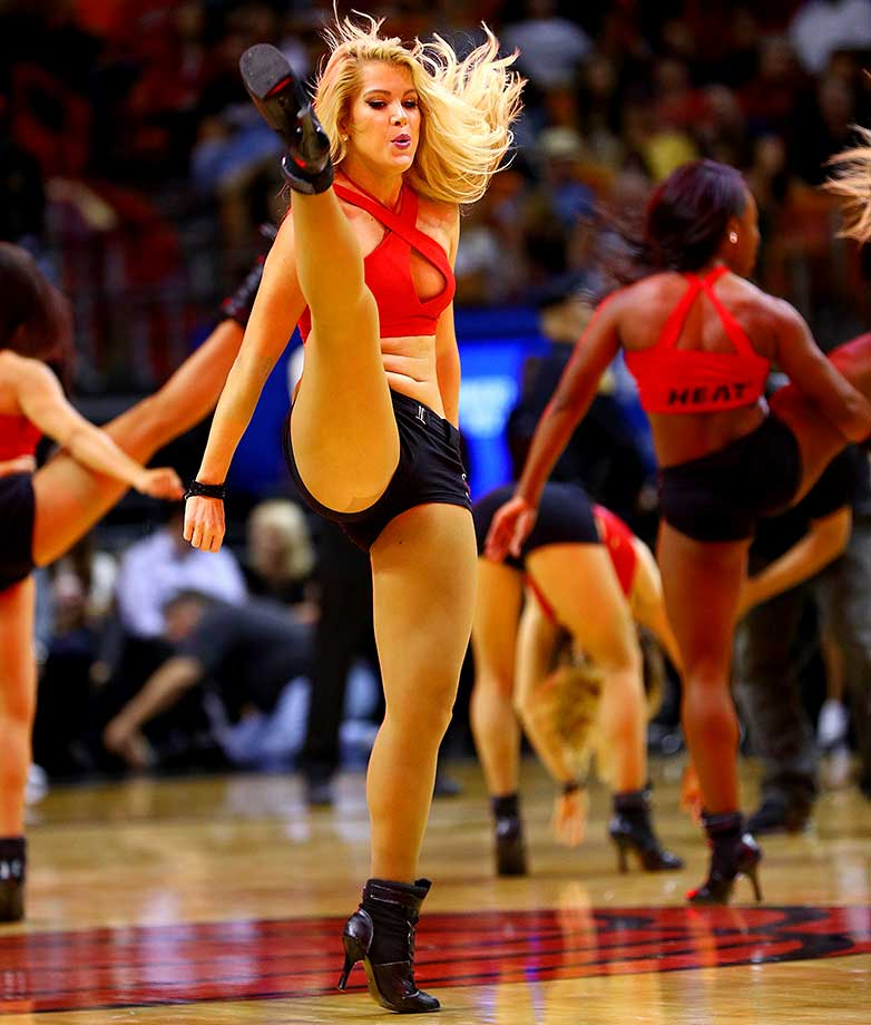 A Miami Heat dancer performs during a game against the Cleveland Cavaliers.