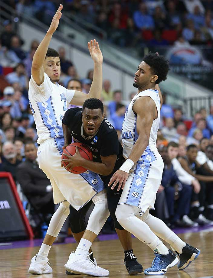 Teammates Justin Jackson and Joel Berry II of North Carolina trap Kyron Cartwright of Providence during an 85-66 win.