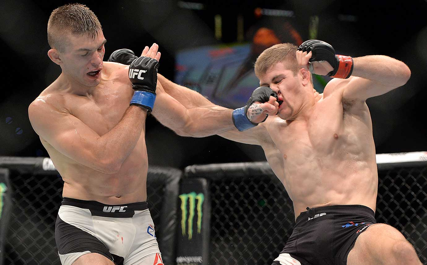 Johnny Case connects against Jake Matthews during their lightweight bout at UFC Brisbane.