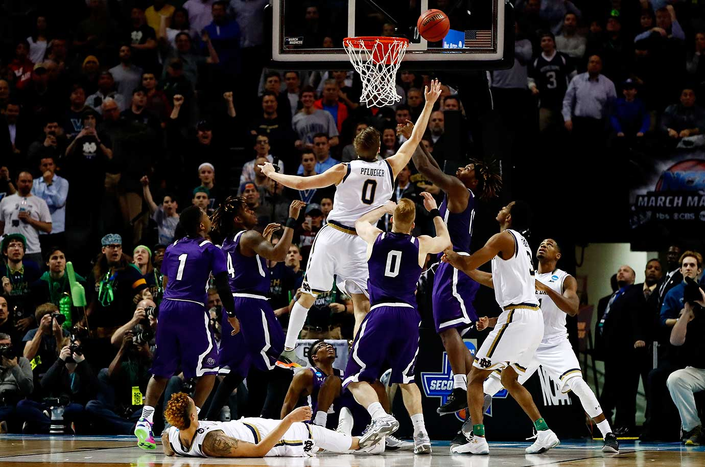 Rex Pflueger's tip-in was his only basket of the game and it pushed Notre Dame into the second weekend of the tournament in consecutive years for the first time since it went six straight years from 1974 to '79.