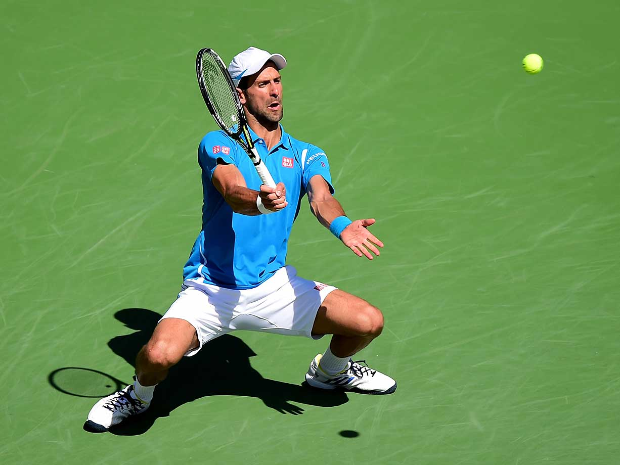 Novak Djokovic of Serbia returns a serve as he beats Milos Raonic of Canada in the final at Indian Wells.