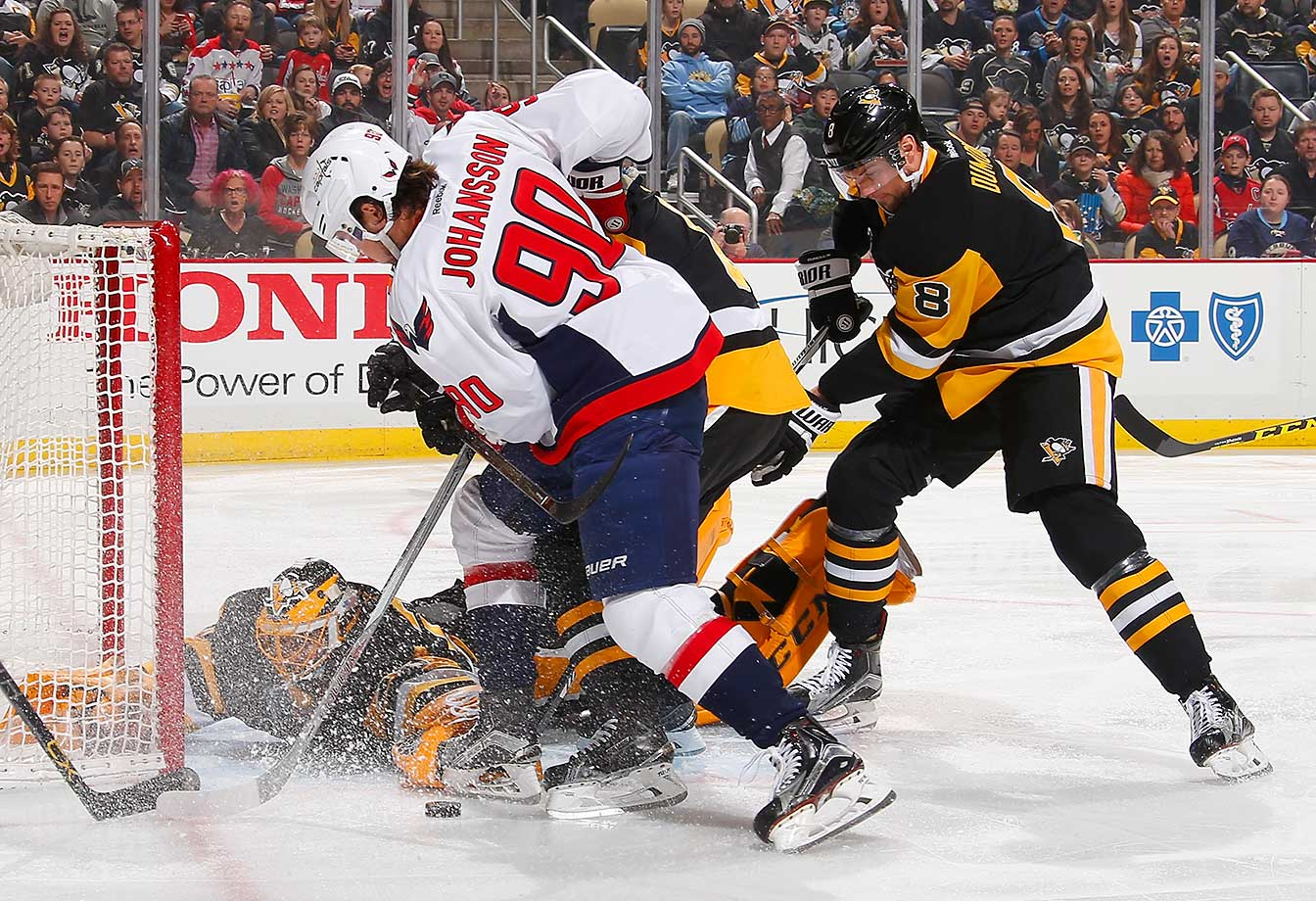 Marc-Andre Fleury of the Pittsburgh Penguins makes a save on a shot by Marcus Johansson of the Washington Capitals.