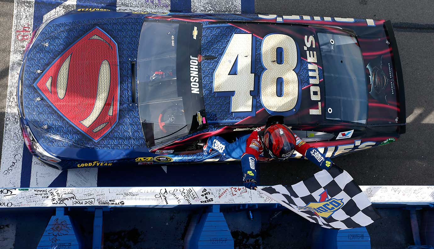 Jimmie Johnson celebrates after taking the checkered flag during the NASCAR Sprint Cup Series Auto Club 400 in Fontana, Calif.
