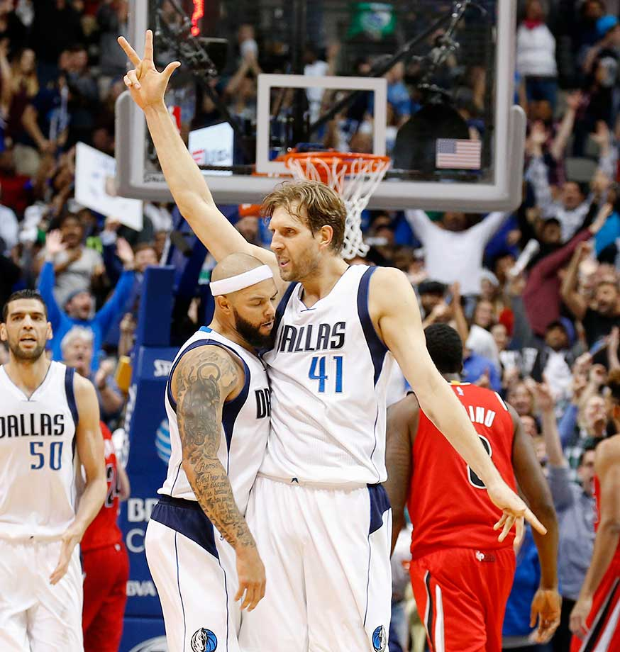 Dallas Mavericks forward Dirk Nowitzki celebrates his overtime three-pointer with guard Deron Williams.