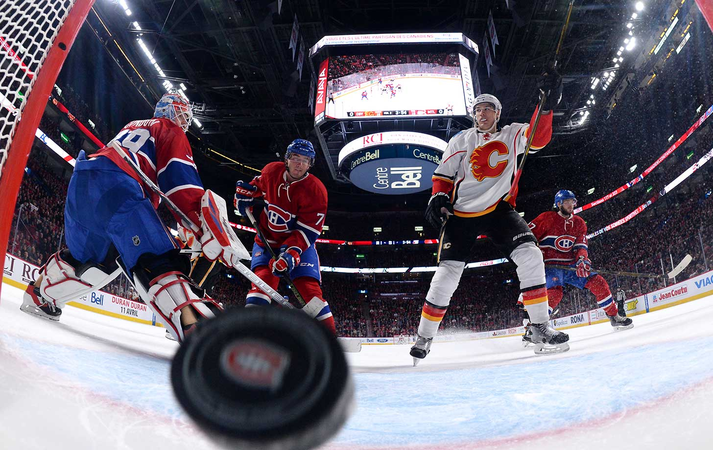 Joe Colborne of the Calgary Flames scores a goal against the Montreal Canadiens.
