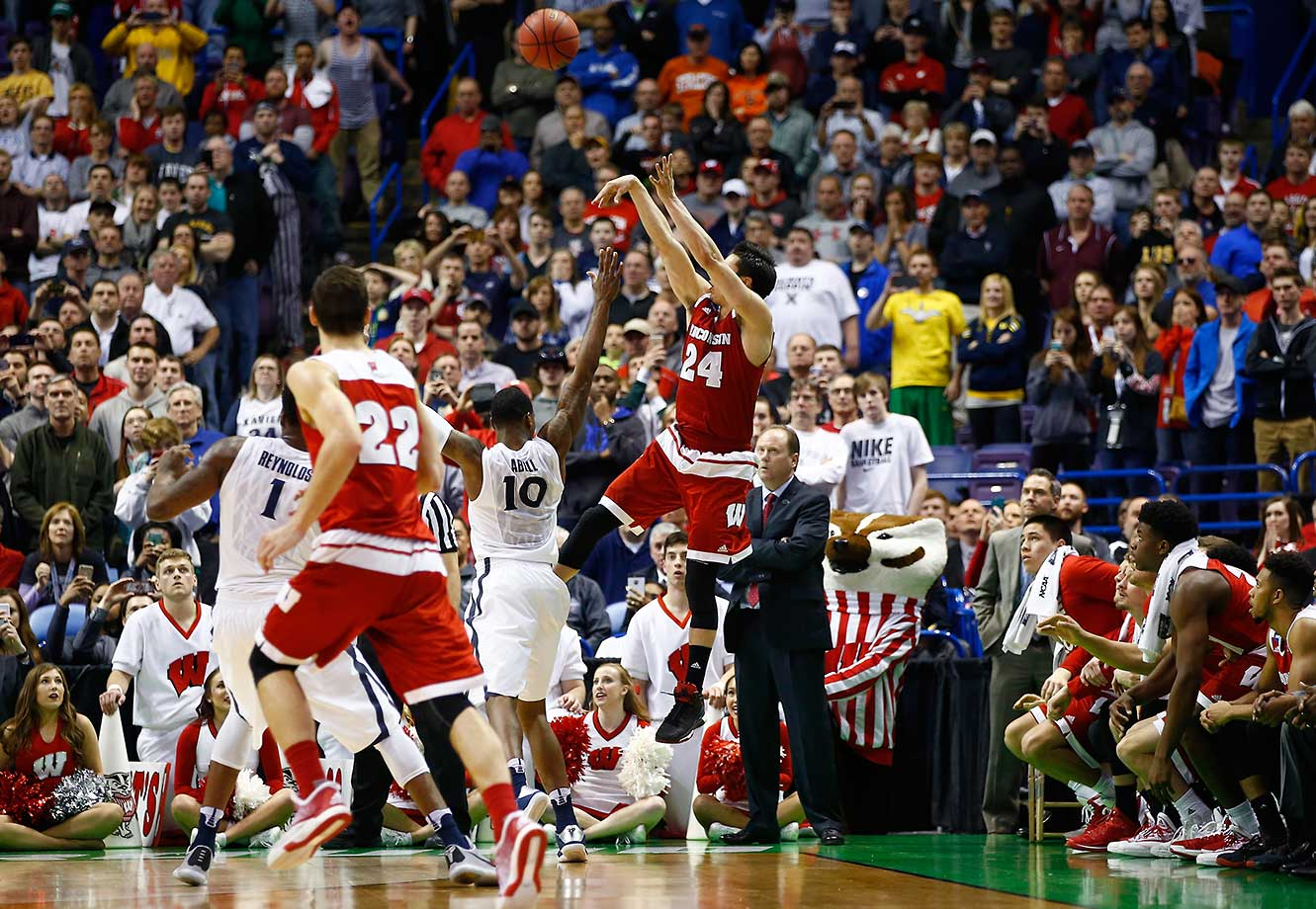 Bronson Koenig of the Wisconsin Badgers shoots the game-winning basket as time expires to defeat two-seed Xavier 66-63.