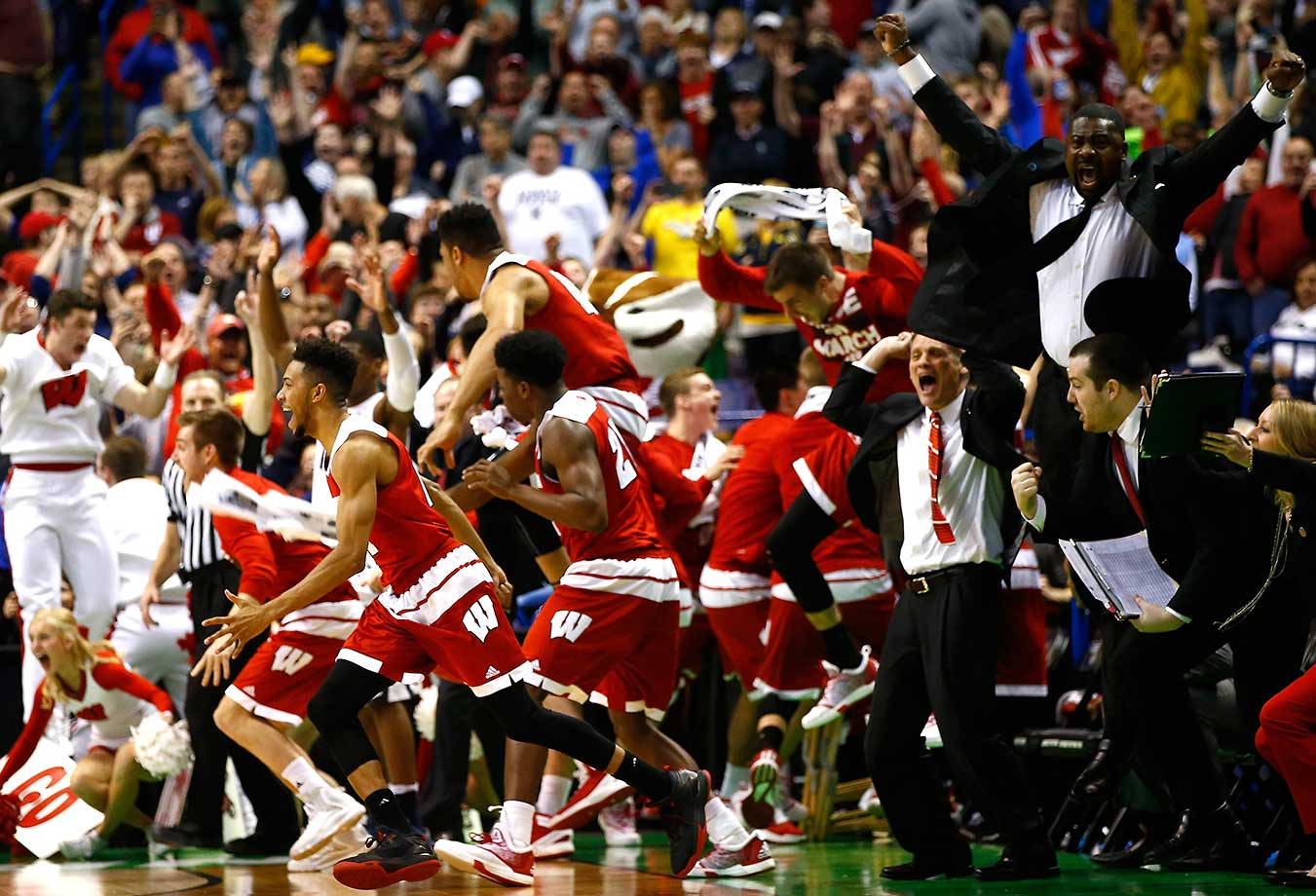 The Wisconsin bench reacts after Bronson Koenig's buzzer beater sent the Badgers to the Sweet 16.