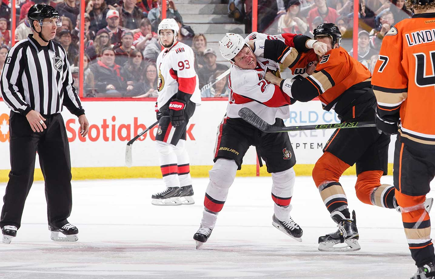 Chris Neil of the Ottawa Senators throws punches against Clayton Stoner of the Anaheim Ducks.