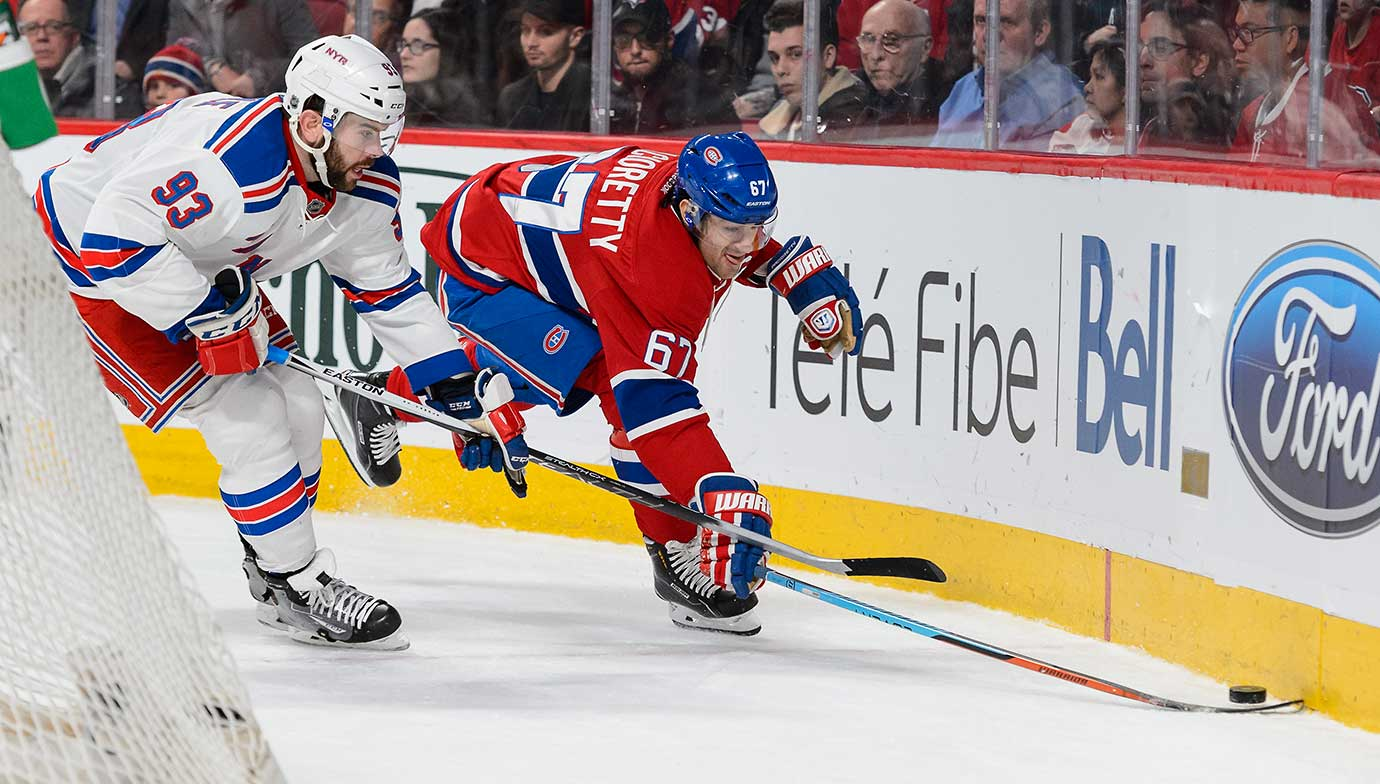 Keith Yandle of the New York Rangers and Max Pacioretty of Montreal chase the puck.