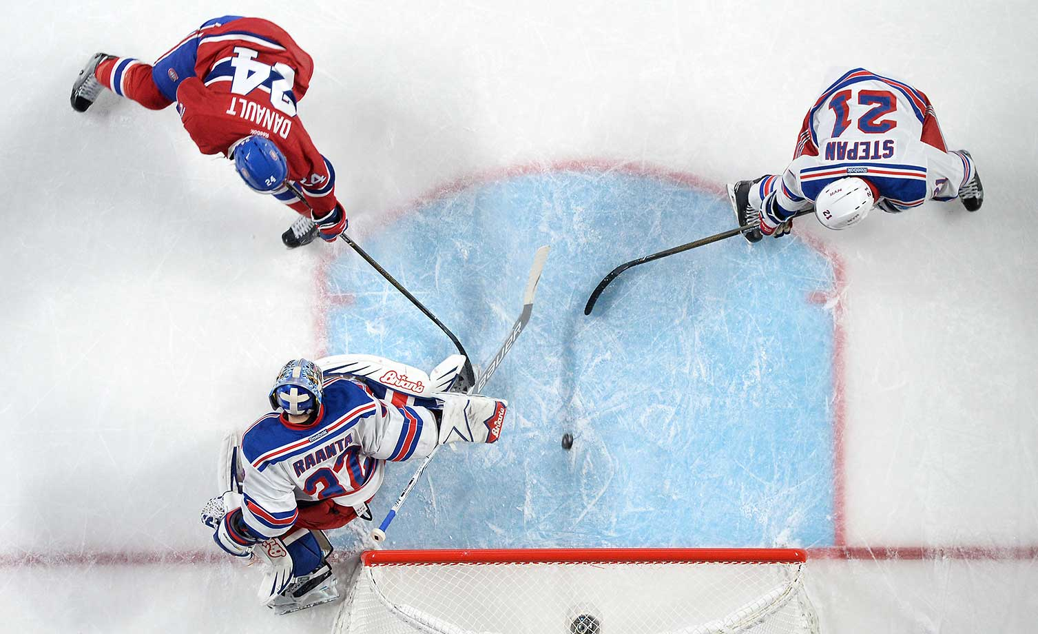 Phillip Danault of the Montreal Canadiens scores a goal against Antti Raanta of the New York Rangers.