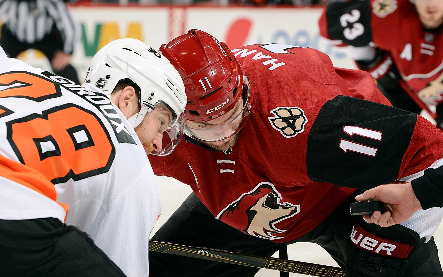 Martin Hanzal of the Arizona Coyotes and Claude Giroux of the Philadelphia Flyers prepare to take a faceoff.