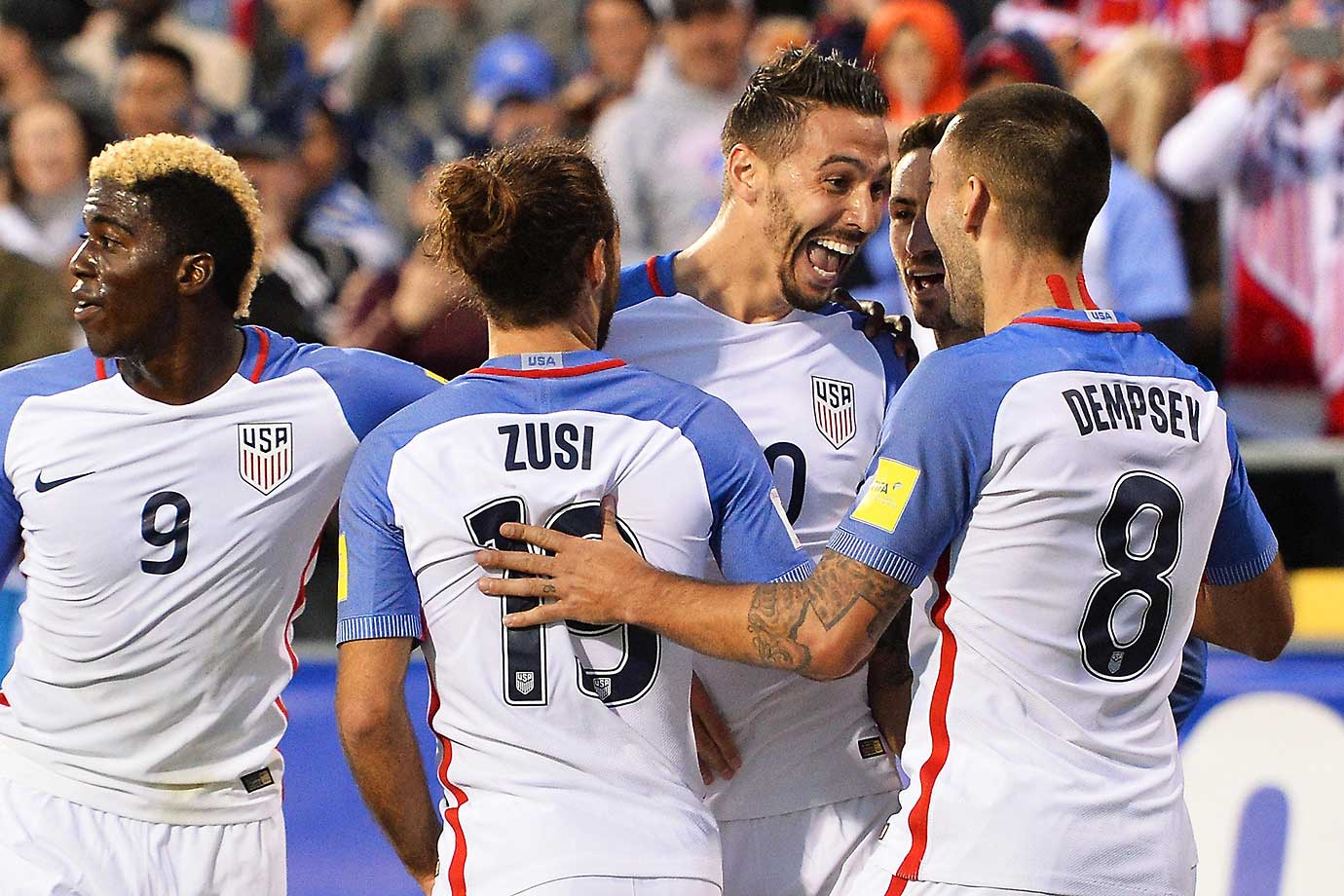 Geoff Cameron (20) celebrates his first half goal against Guatemala with Graham Zusi and Clint Dempsey.