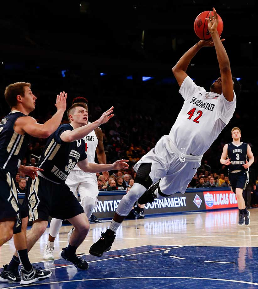 Jeremy Hemsley of San Diego State shoots a fadeaway against the George Washington Colonials during an NIT Championship Semifinal game.
