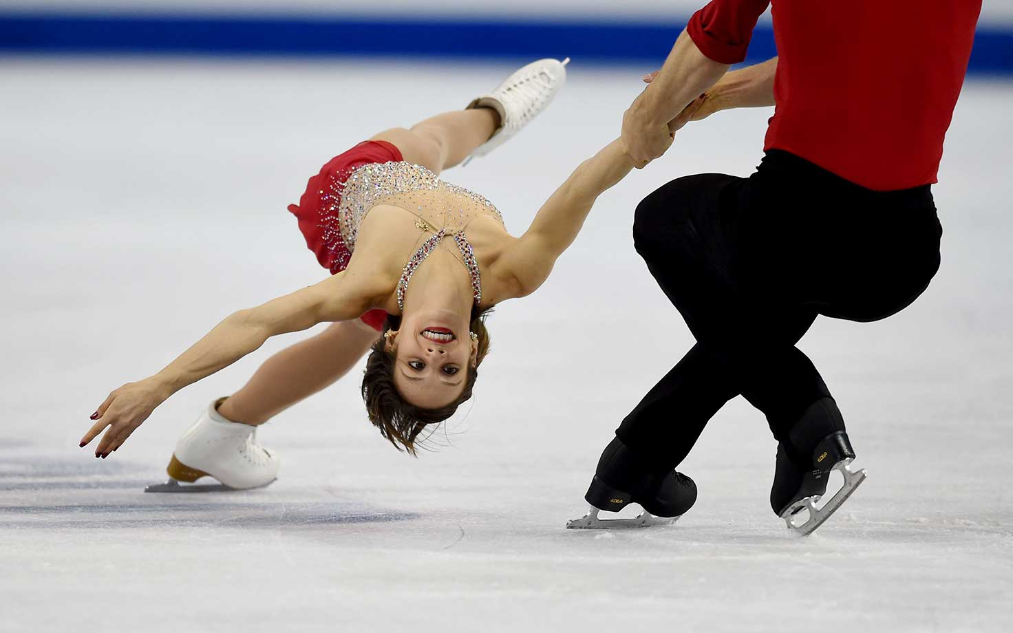 Meagan Duhamel and Eric Radford of Canada perform their short program in the Pairs competition.