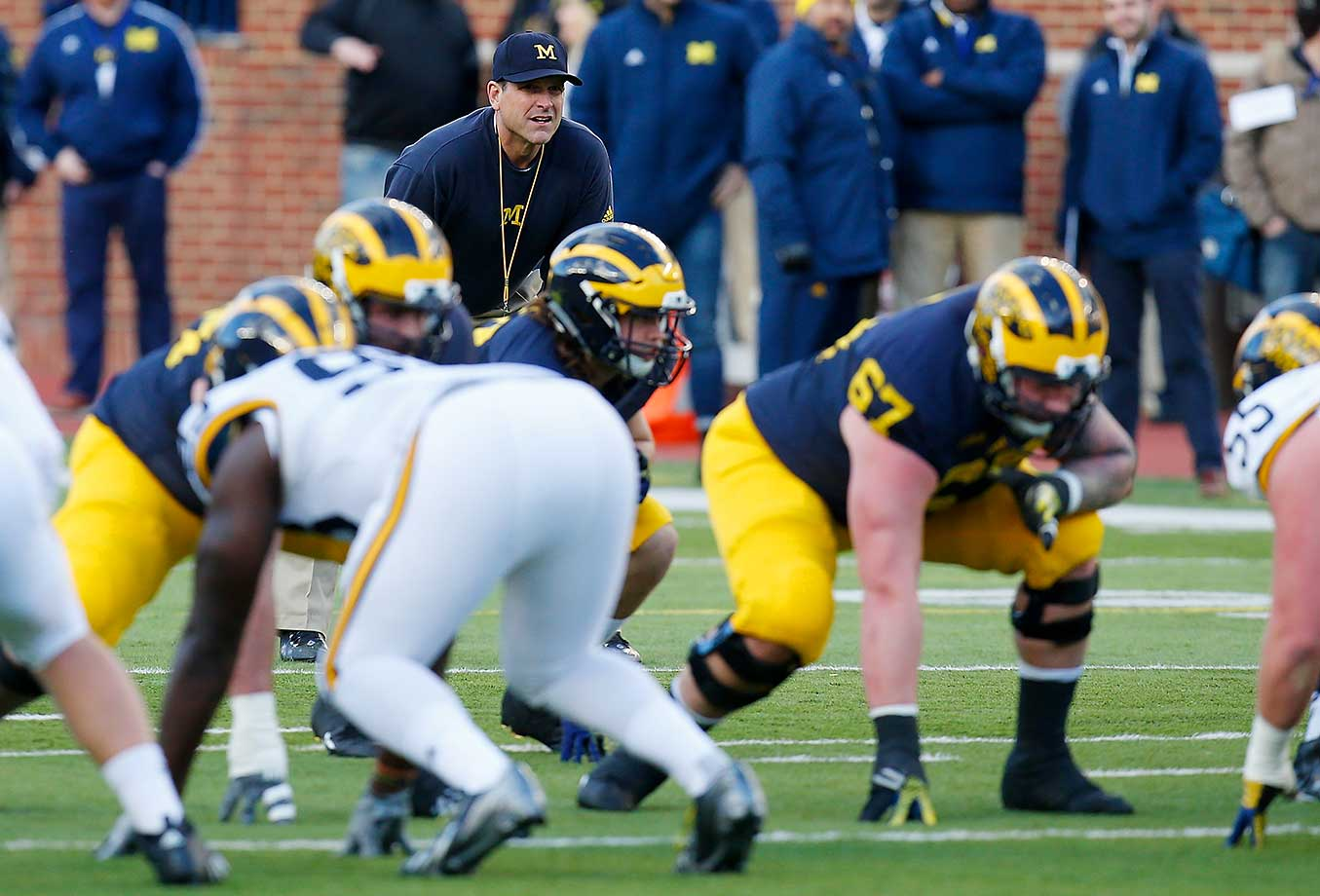 Head coach Jim Harbaugh watches play during the Michigan spring game in Ann Arbor.