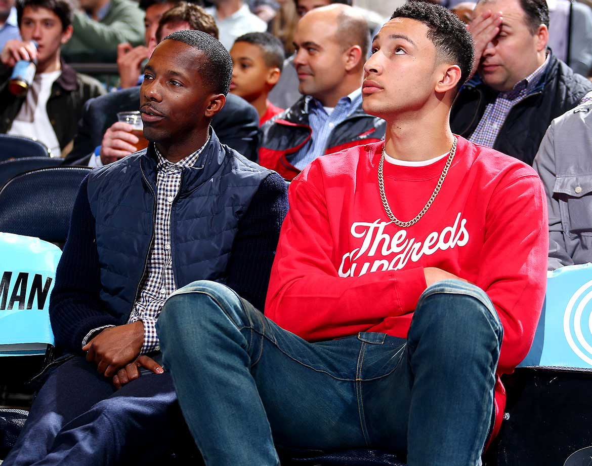 College basketball player Benjamin Simmons and his agent, Rich Paul, watch the New York Knicks play against the Brooklyn Nets.
