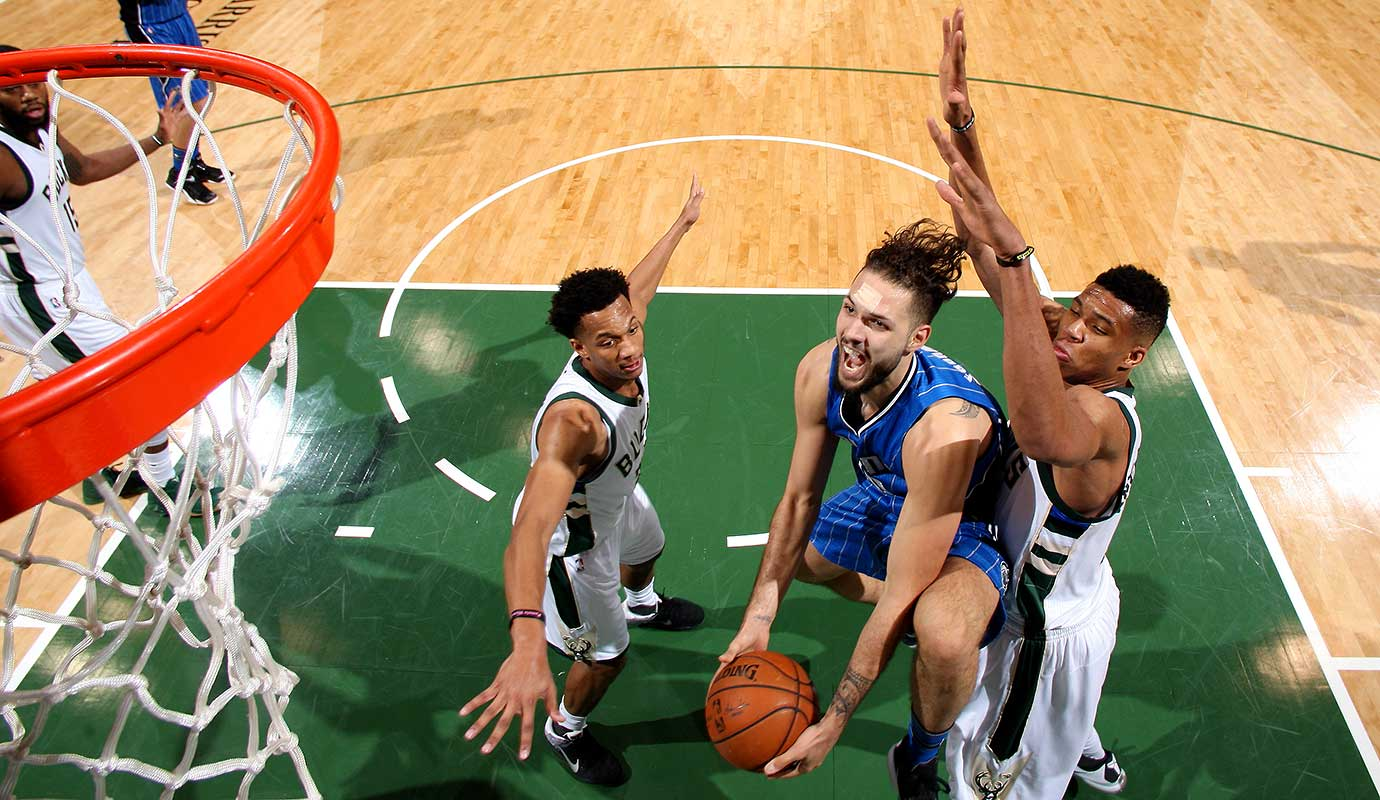 Evan Fournier of the Orlando Magic goes for the layup during the game against the Milwaukee Bucks.