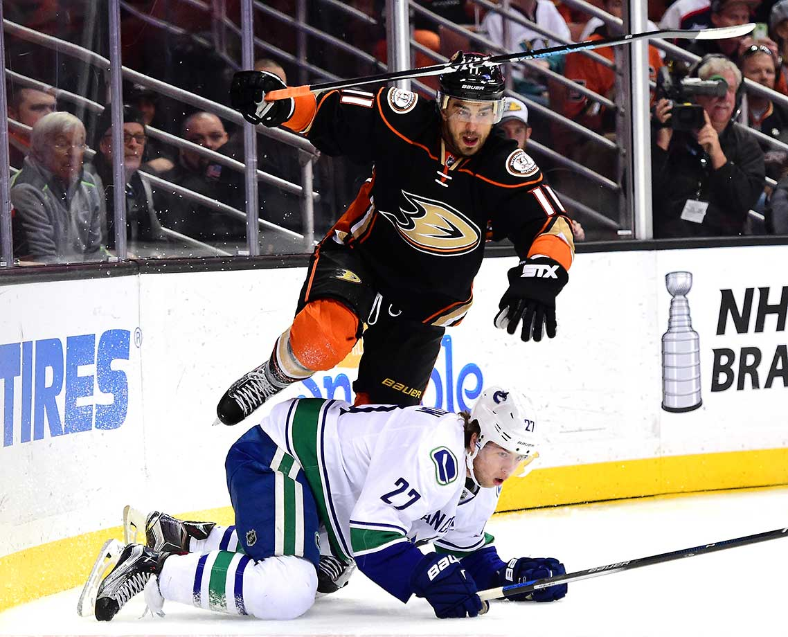 Brandon Pirri of the Anaheim Ducks jumps over Ben Hutton of the Vancouver Canucks.
