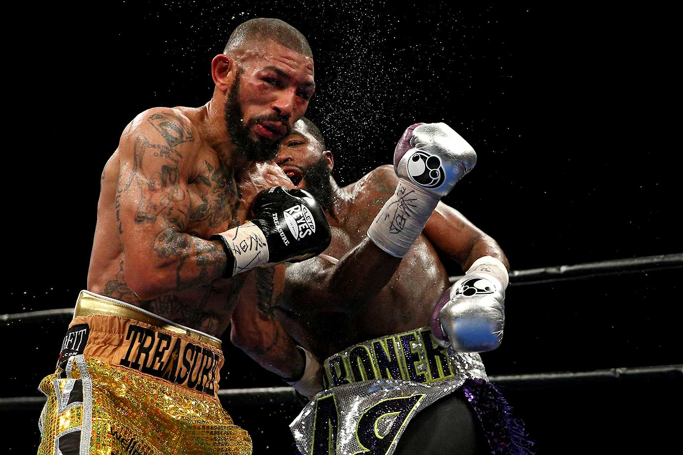 Ashley Theophane (left) and Adrien Broner exchange punches in their super lightweight championship bout in Washington, D.C.