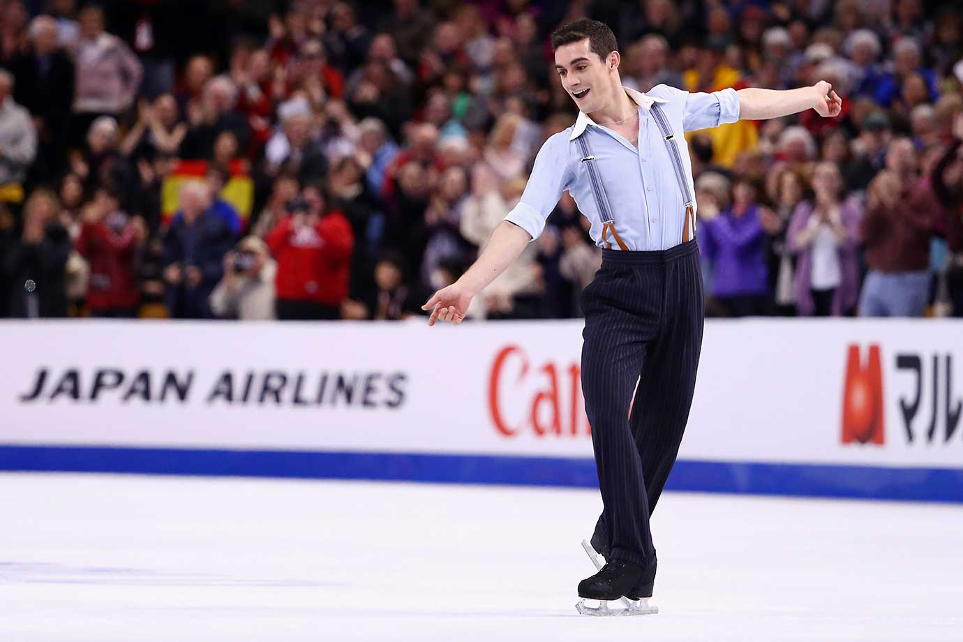 Javier Fernandez of Spain defended his world title by overcoming a 12. point deficit with a 216.41 in his free skate to finish with a 314.93 total.