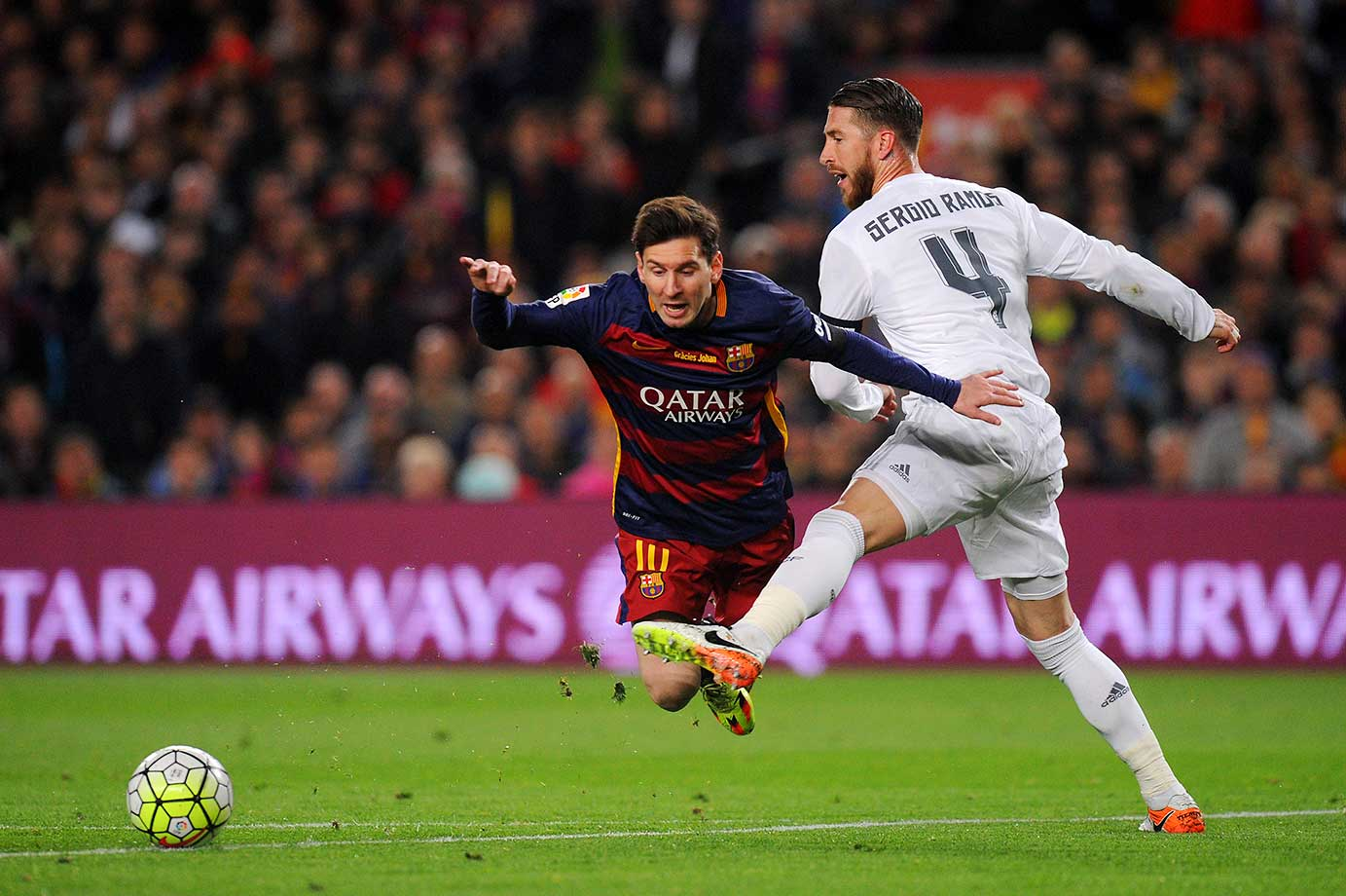 Sergio Ramos of Real Madrid battles for the ball with Lionel Messi of Barcelona during their La Liga match.