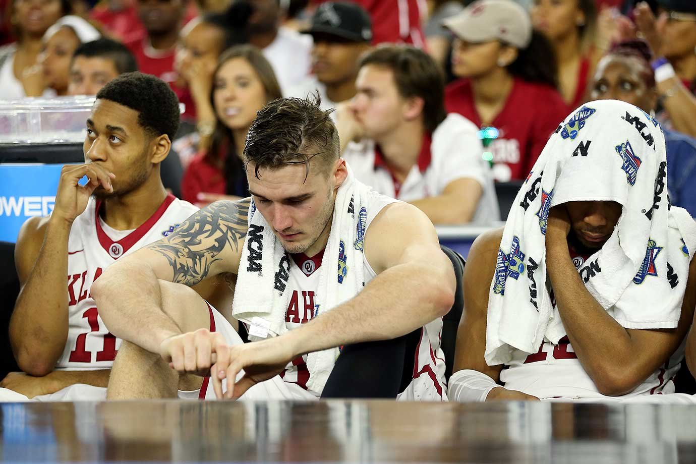 Isaiah Cousins, Ryan Spangler and Khadeem Lattin of the Oklahoma Sooners look on from the bench in the loss to Villanova.