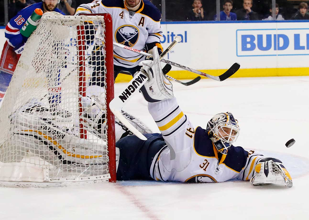 Chad Johnson of the Buffalo Sabres makes a save against the New York Rangers.