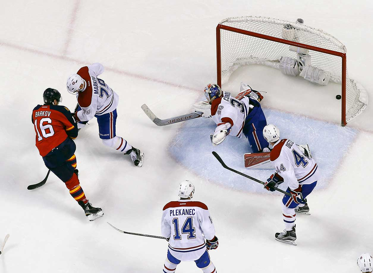 Aleksander Barkov of Florida scores a second period goal against goaltender Mike Condon of Montreal.