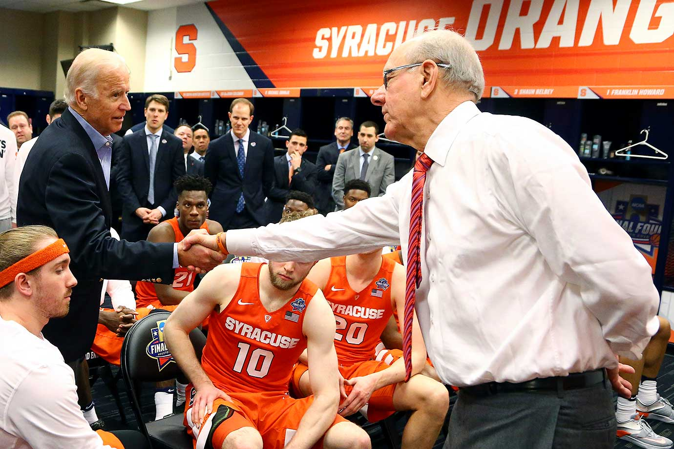 Vice president and Syracuse alum Joe Biden shakes hands with coach Jim Boeheim as he visits the team after the loss to North Carolina.