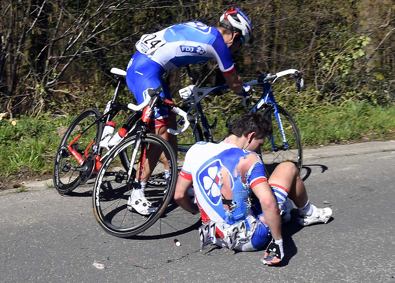 French cyclist Arnaud Demare on the ground after being injured during the 100th edition of the Tour of Flanders.