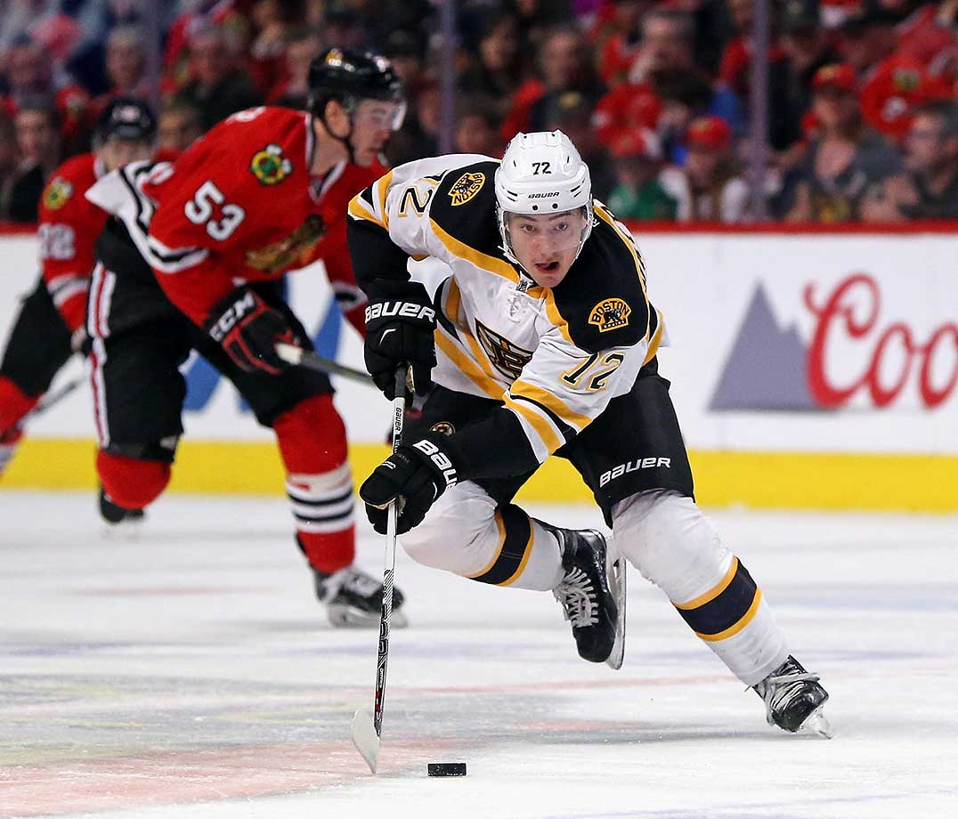 Frank Vatrano of the Boston Bruins advances the puck against the Chicago Blackhawks.