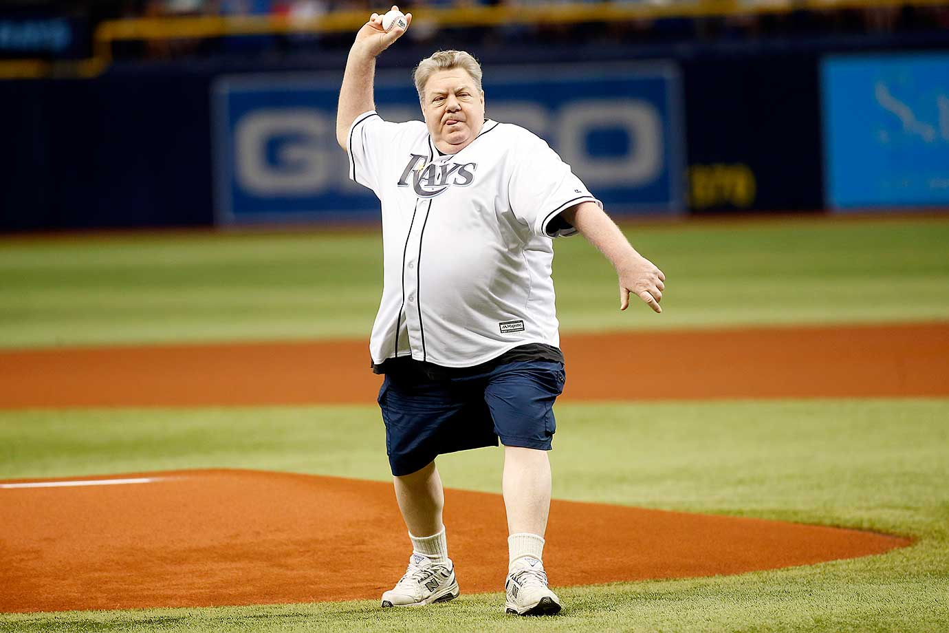 Actor George Wendt throws out the ceremonial first pitch before the start of the Tampa Bay Rays' Opening Day game against Toronto.