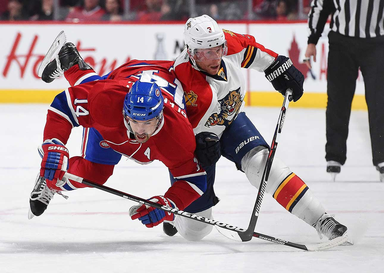 Steven Kampfer of the Florida Panthers tries to slow down Tomas Plekanec of Montreal.