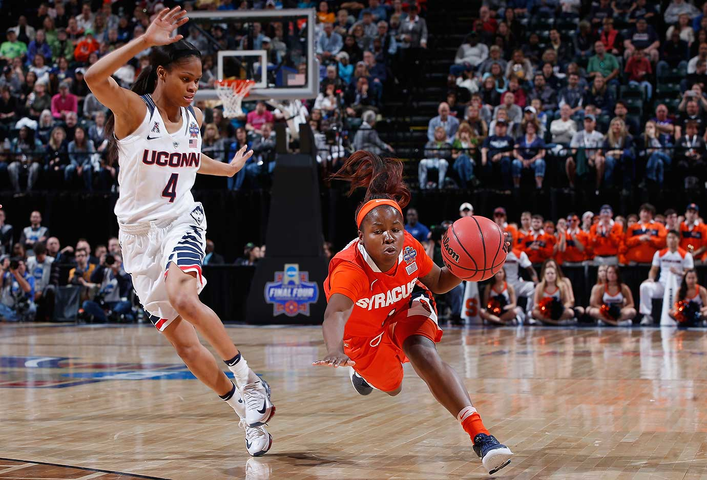 Alexis Peterson of Syracuse drives against Moriah Jefferson of Connecticut in the women's national title game.