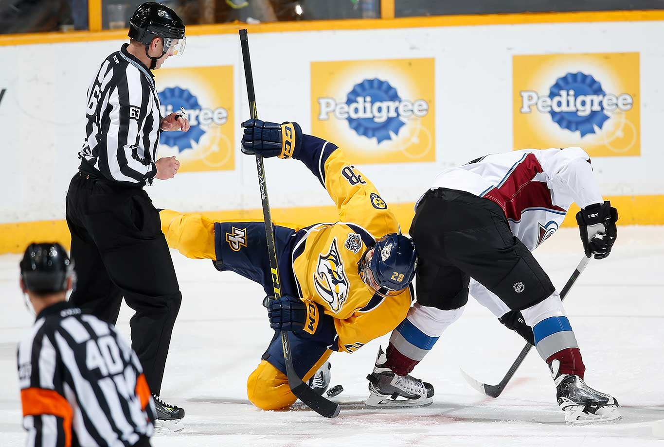Paul Gaustad (28) of Nashville battles in a face-off against Jack Skille of Colorado.