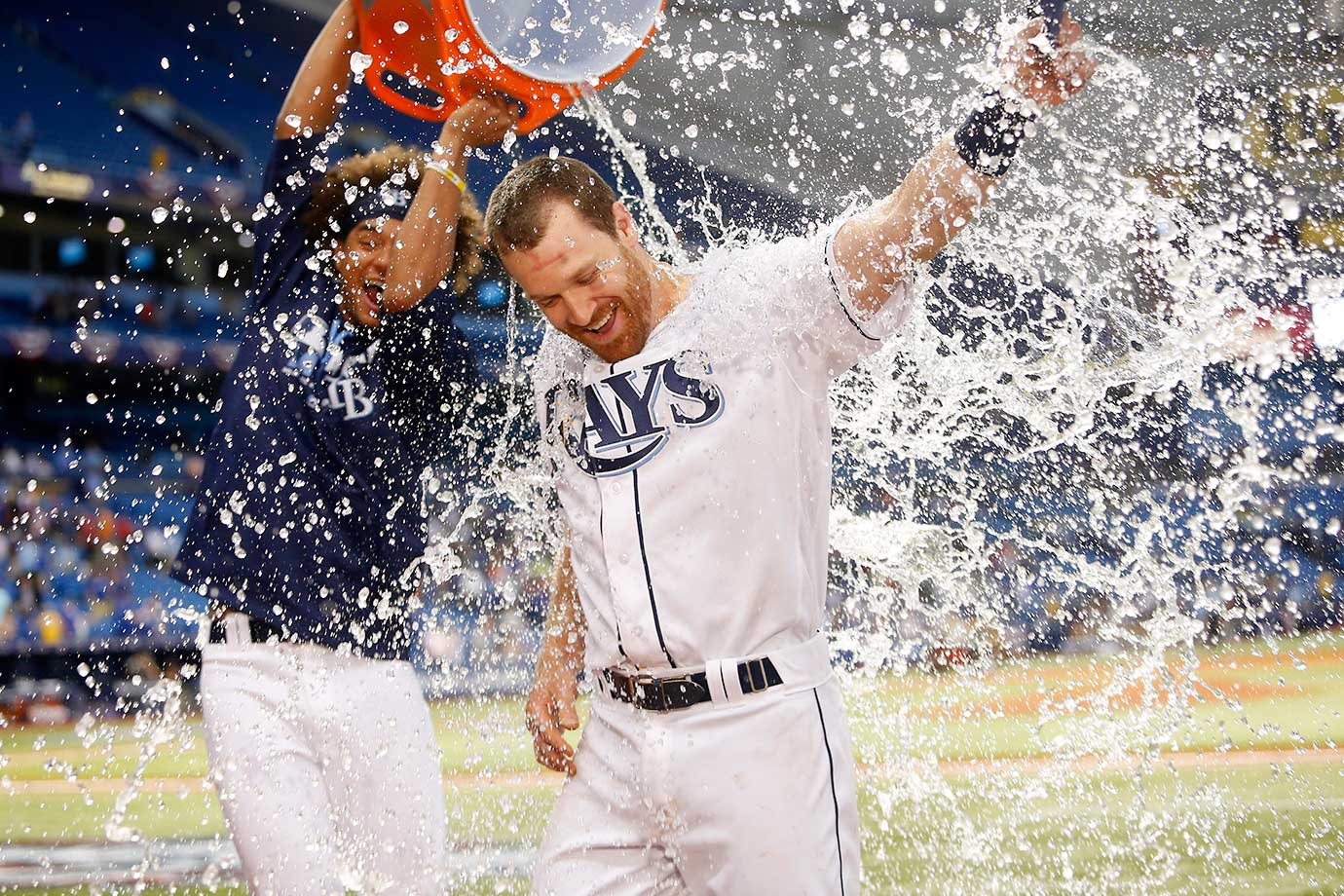 Second baseman Logan Forsythe of Tampa Bay is doused with ice and water by pitcher Chris Archer following the Rays' 3-2 win over Toronto.