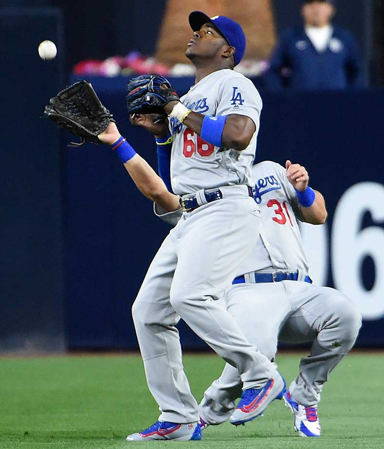 Yasiel Puig of the Los Angeles Dodgers steps in front of Joc Pederson to make a catch against the San Diego Padres.