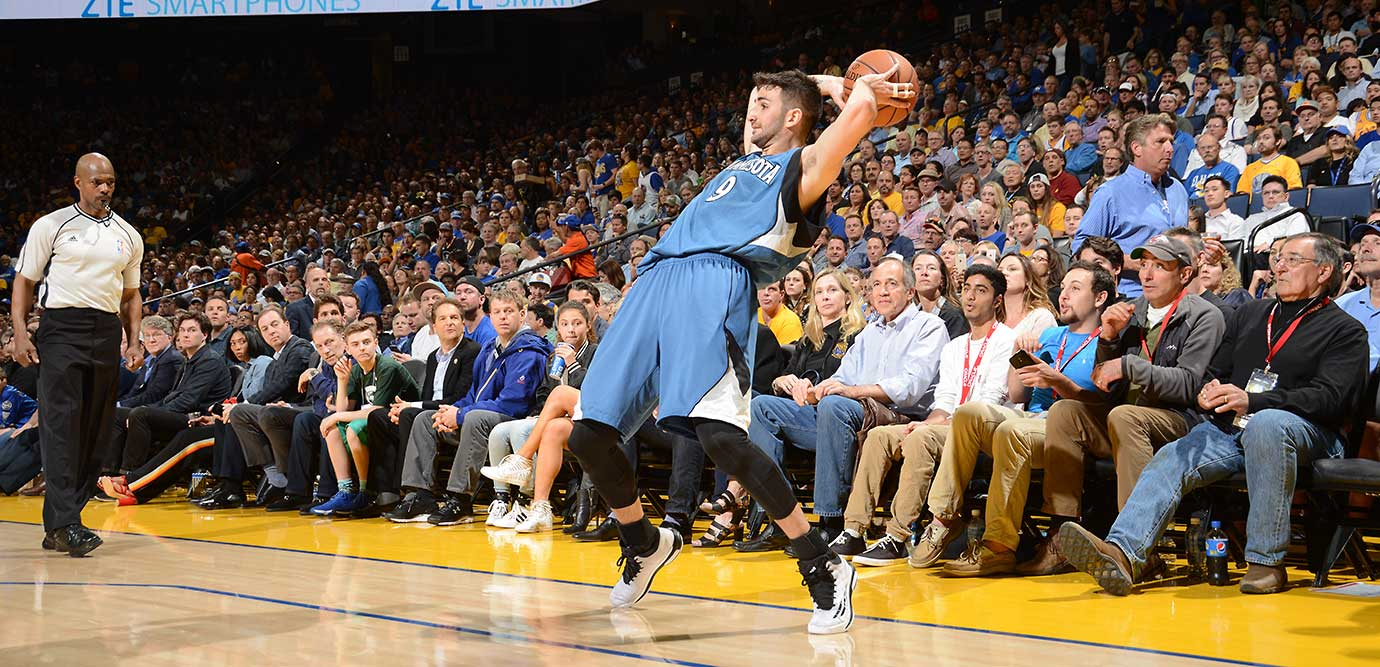 Ricky Rubio of the Minnesota Timberwolves tries to keep his balance and get off a pass against Golden State.