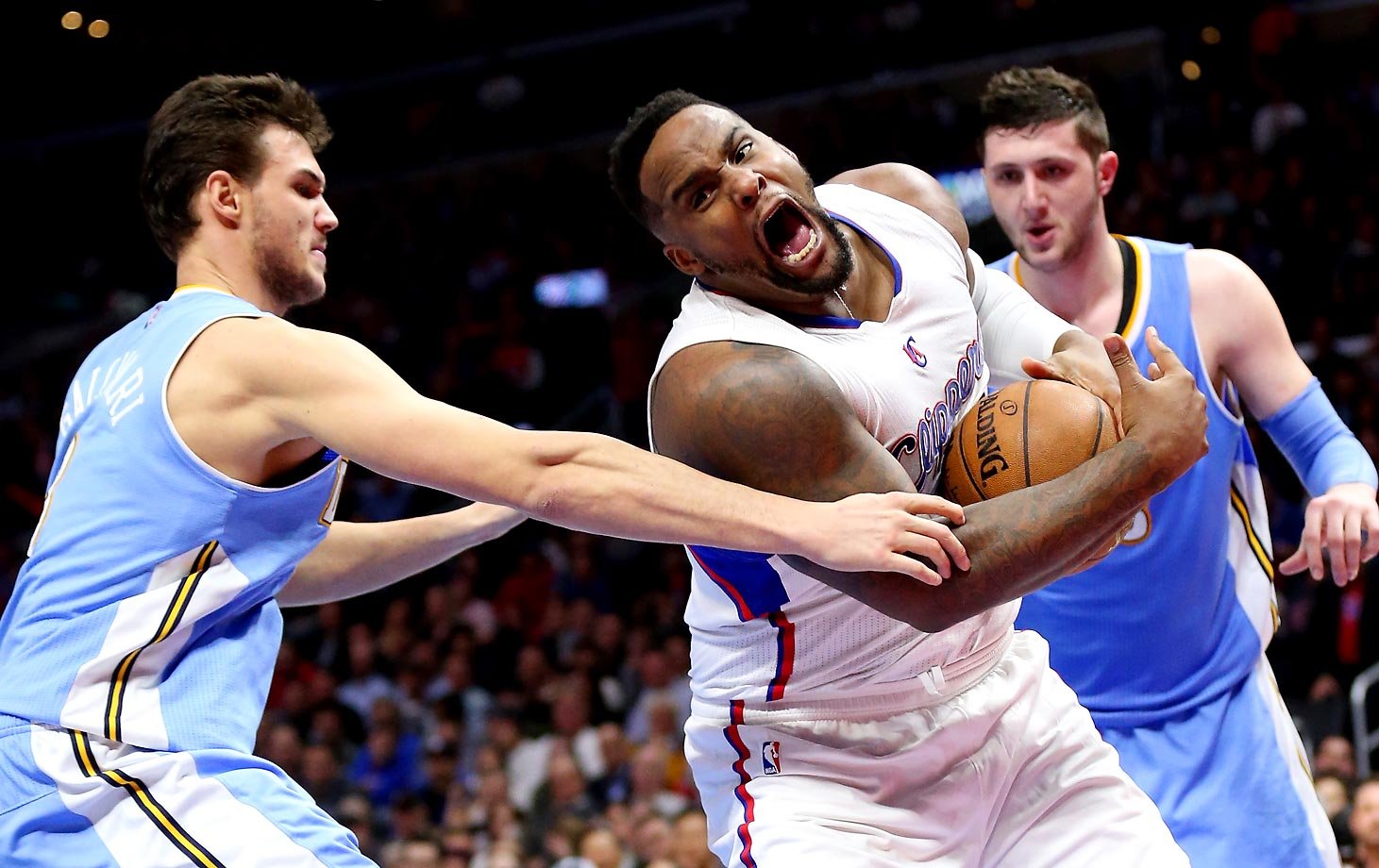 Glen Davis of the Los Angeles Clippers fights to control a loose ball against Danilo Gallinari of the Denver Nuggets. The Clippers won 102-98.