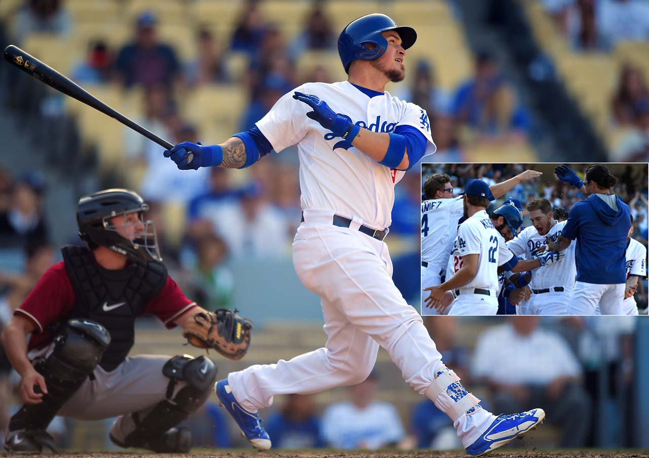Yasmani Grandal of the Los Angeles Dodgers nails a pitch for the only run of the game, a 13th-inning walk-off homer against the Arizona Diamondbacks on May 3.