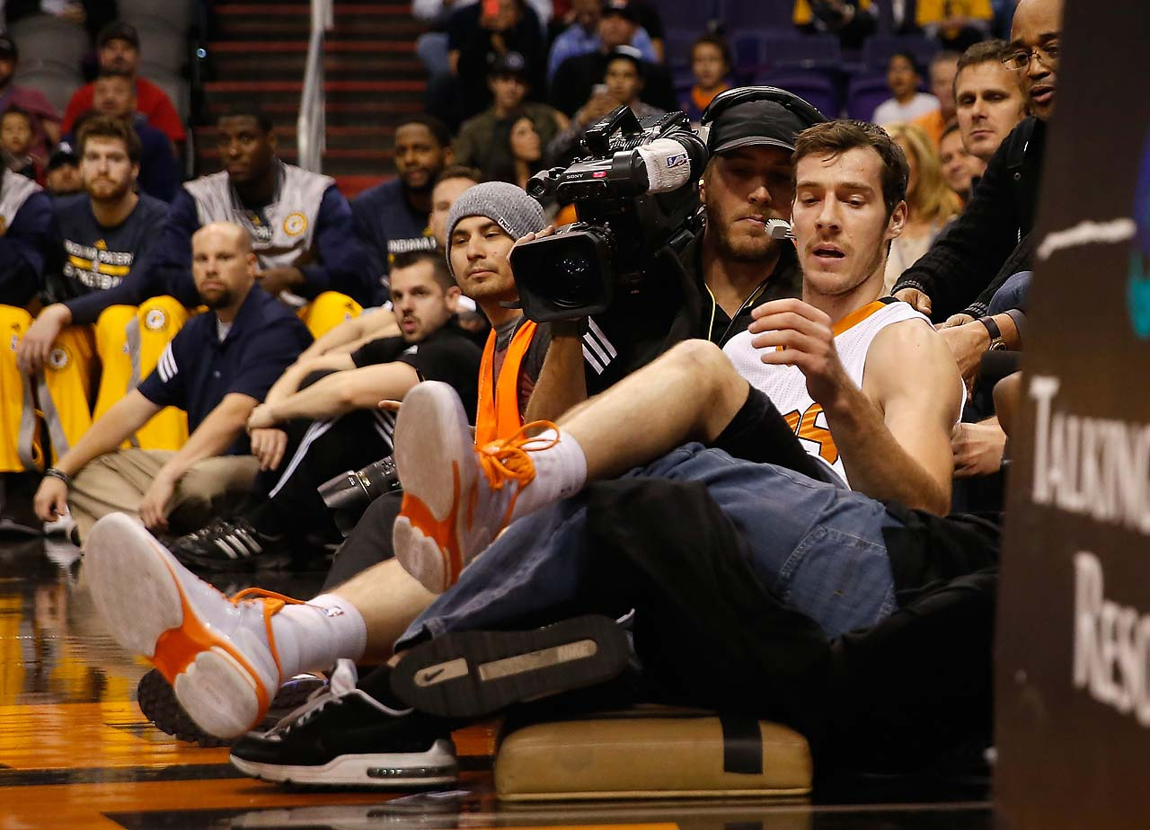 Goran Dragic of the Phoenix Suns falls onto a cameraman during a December 2014 game against Indiana.