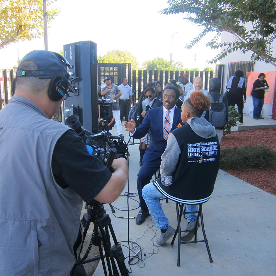 CBS Los Angeles sports anchor Jim Hill films a sit-down interview with Nia Toliver, SI's High School Athlete of the Month for October. A member of the Girls' High School All-America team, Toliver has participated in several Olympic development training camps. She wants to compete in the Ivy League in college and at the Rio Olympics in 2016, when women's sevens rugby will be an Olympic sport for the first time.