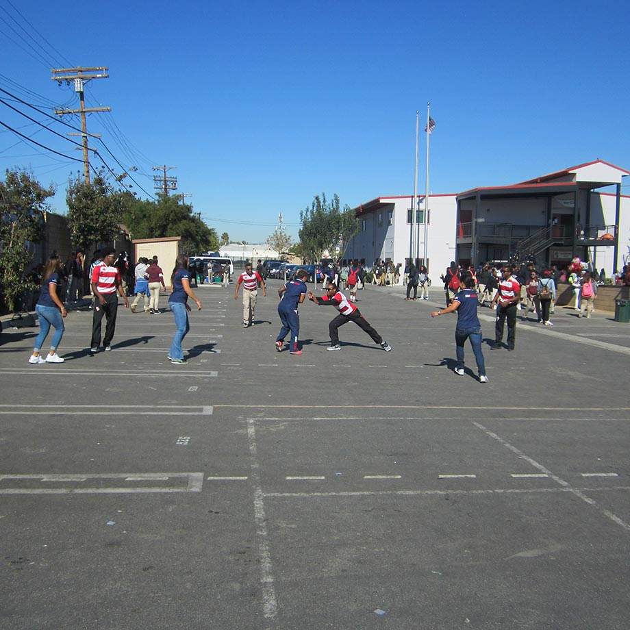 Members of the USA Rugby national team play a pick-up game against View Park High's rugby team on the school's blacktop. The charter school is part of the Inner City Education Foundation Rugby program, founded by head coach Stuart Krohn in 2002.