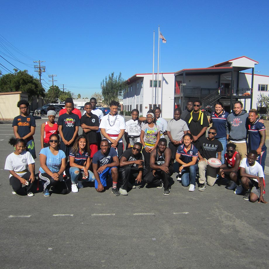 View Park High rugby student-athletes pose with members of the USA Rugby team after a game of flag rugby.