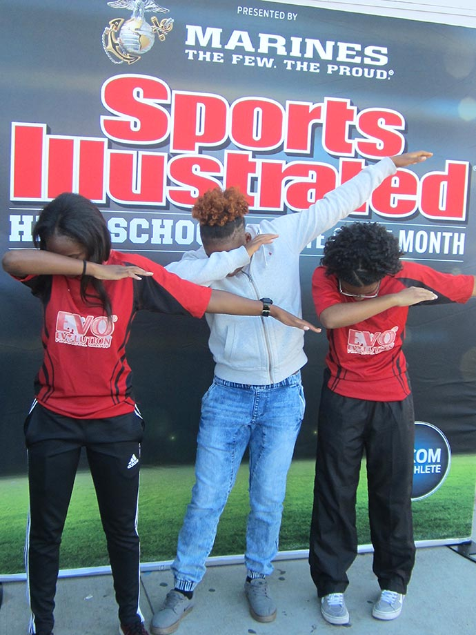 View Park High senior rugby wing Nia Toliver strikes a pose with two teammates at an event to celebrate her selection as SI's High School Athlete of the Month, presented by the U.S. Marine Corps.